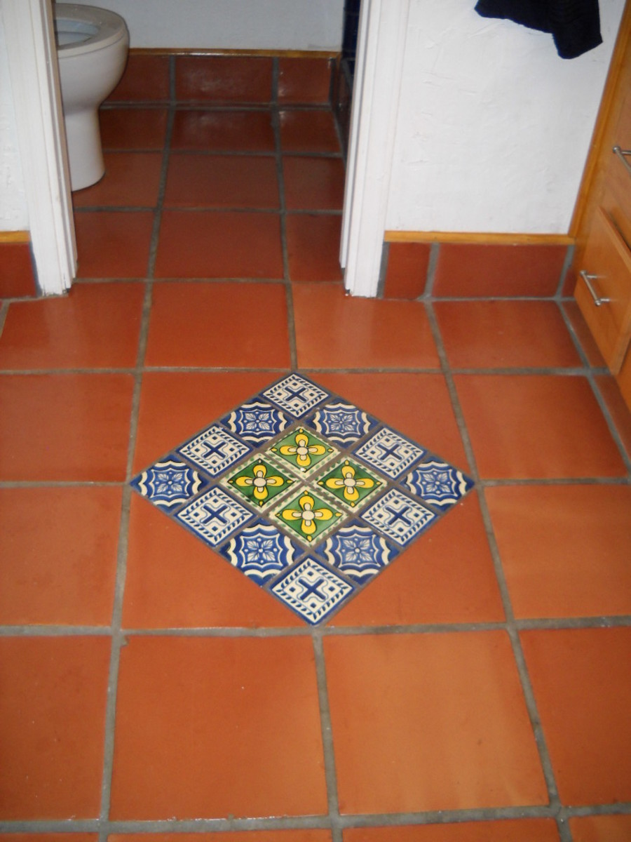 How to design kitchens and bathrooms using mexican for Mexican tile bathroom ideas