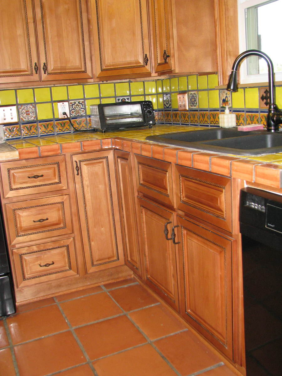 Consider how main color works with cabinets, floors and general design of room.