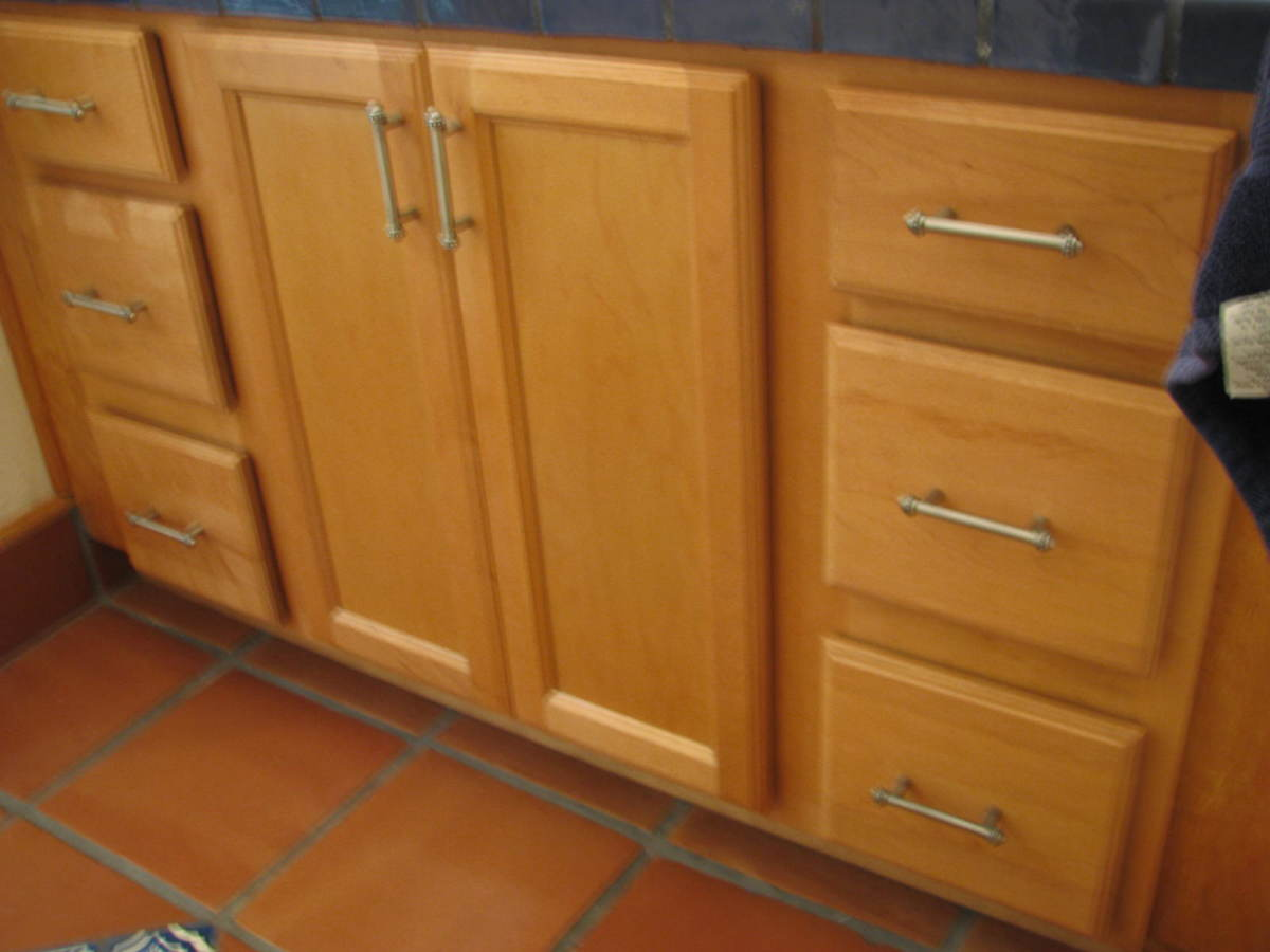 Home Depot cabinets have cheaper doors and a wide space between drawers.