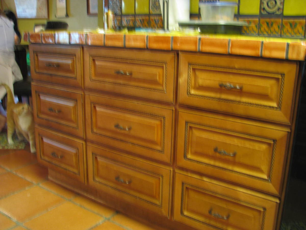 Cabinet drawers are deep  and full-face.