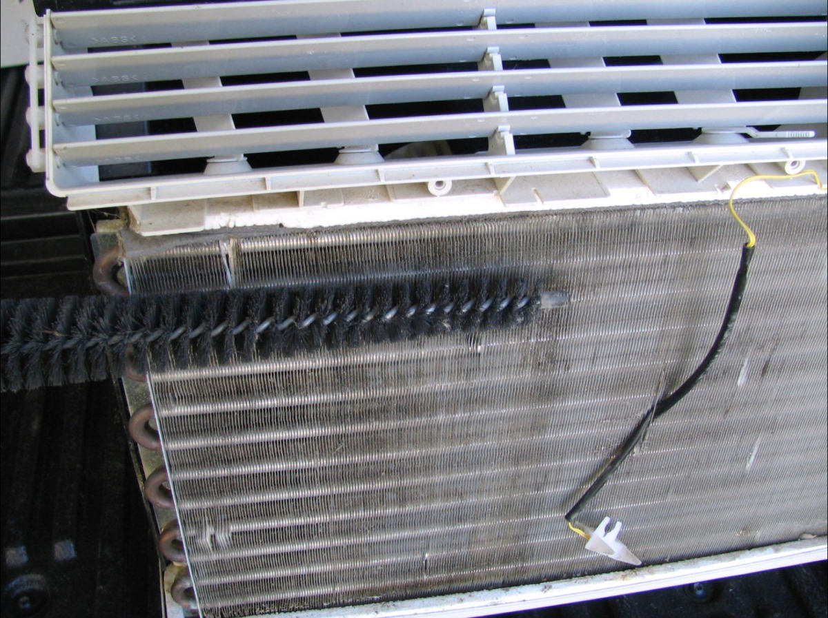 You can use a dryer vent brush to get the dust off of aluminum AC fans.