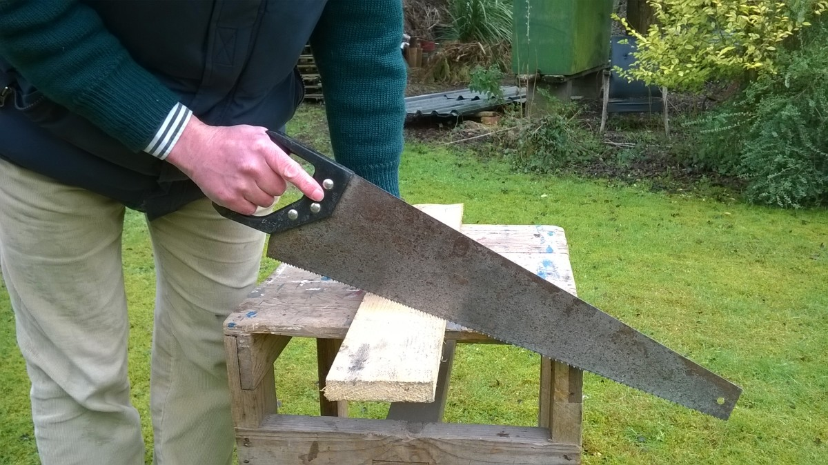 A hand saw is useful for cutting the odd length of timber, without the hassle of taking out power tools and an extension lead