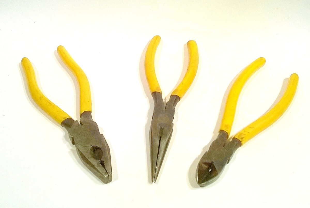 From left to right, standard pliers, long (snipe) nose pliers, wire snips (side cutters)