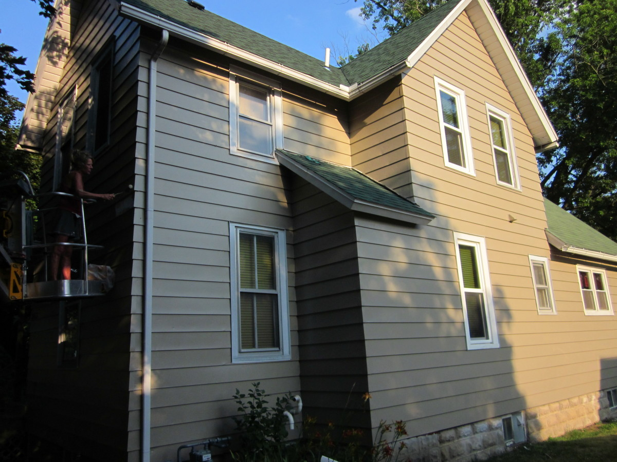 painting-the-exterior-of-a-two-story-house