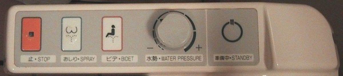 Control panel of a medium sophisticated japanese toilet, located in the Asahikawa grand hotel in Asahikawa, Japan.