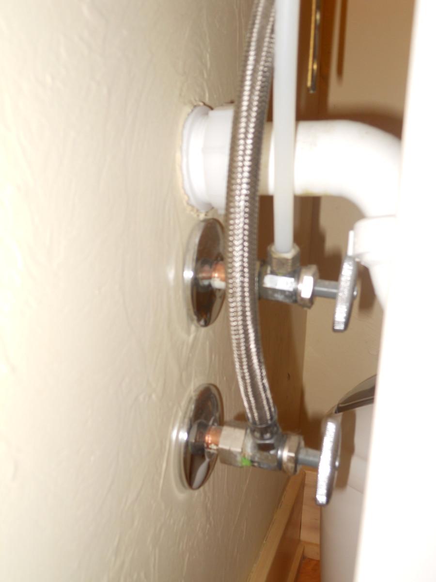 Stop valves behind pedistal sink