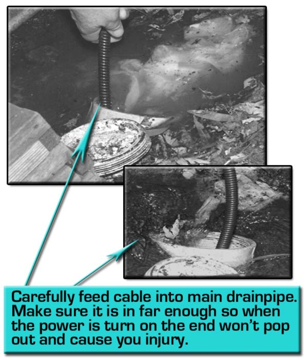 Carefully feed the auger cable into the drain.