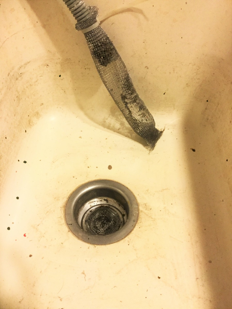 Here is my sink with the lint catcher attached to the hose. You can see the in-sink lint catcher in the drain.  It does catch more lint and I'm using it now all the time.  I do have to clean it after every load.