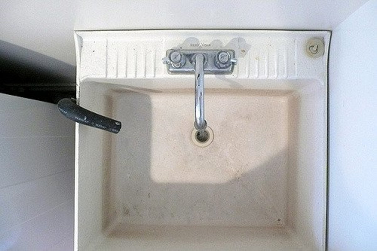 This setup needs a lint catcher.  You need to put it over the black pipe coming out from the washer and draining into the sink.