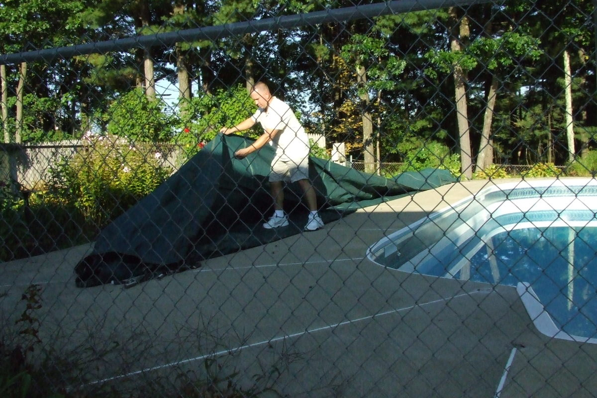 That is me unrolling the pool cover, see, I really do what I say I do :)