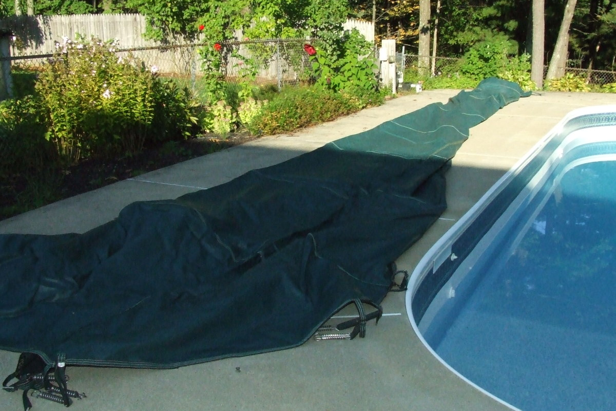 Lay out the cover on the side of the pool so you can slide it over the pool easily. It's nice to have two people when installing the cover, but not necessary.