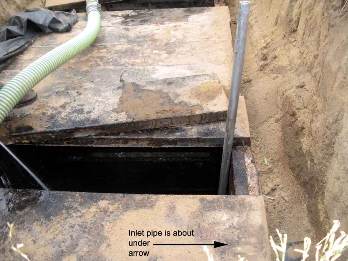 Inlet pipe shown entering from outside the tank