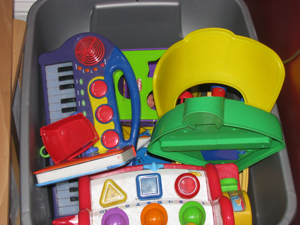 Larger toys are placed in a storage container with a lid.
