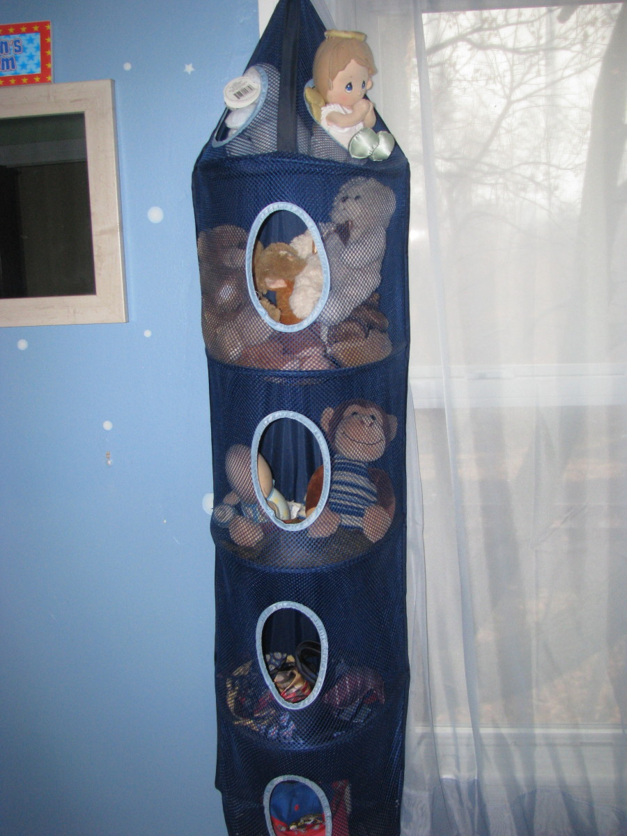 Stuffed animals are kept in a hanging toy organizer in my son's room.