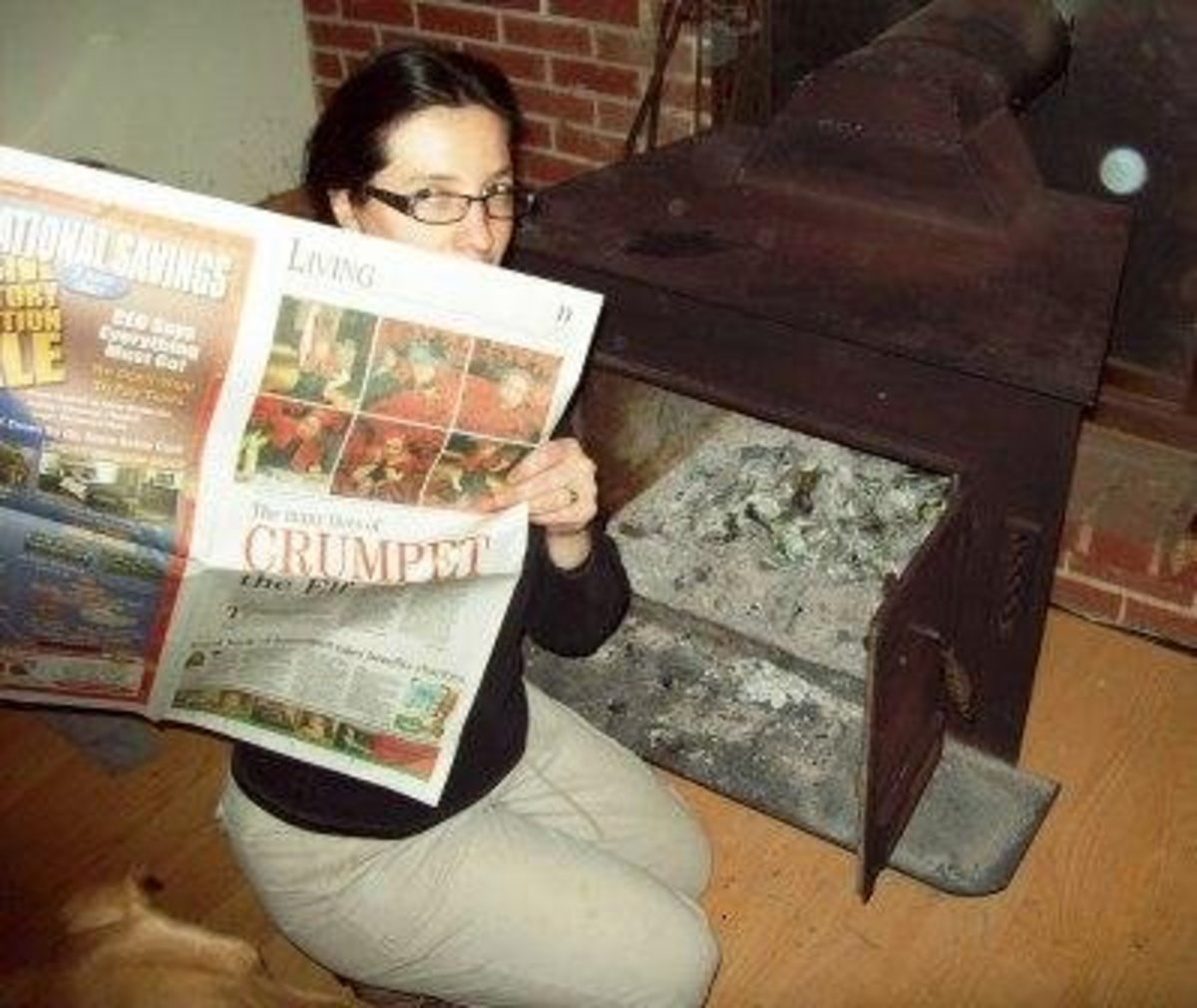"""I probably should save this piece of newspaper for gift wrap.  But, I decided to """"reuse"""" it anyway - in the wood stove.  Notice the little orb in the camera view."""