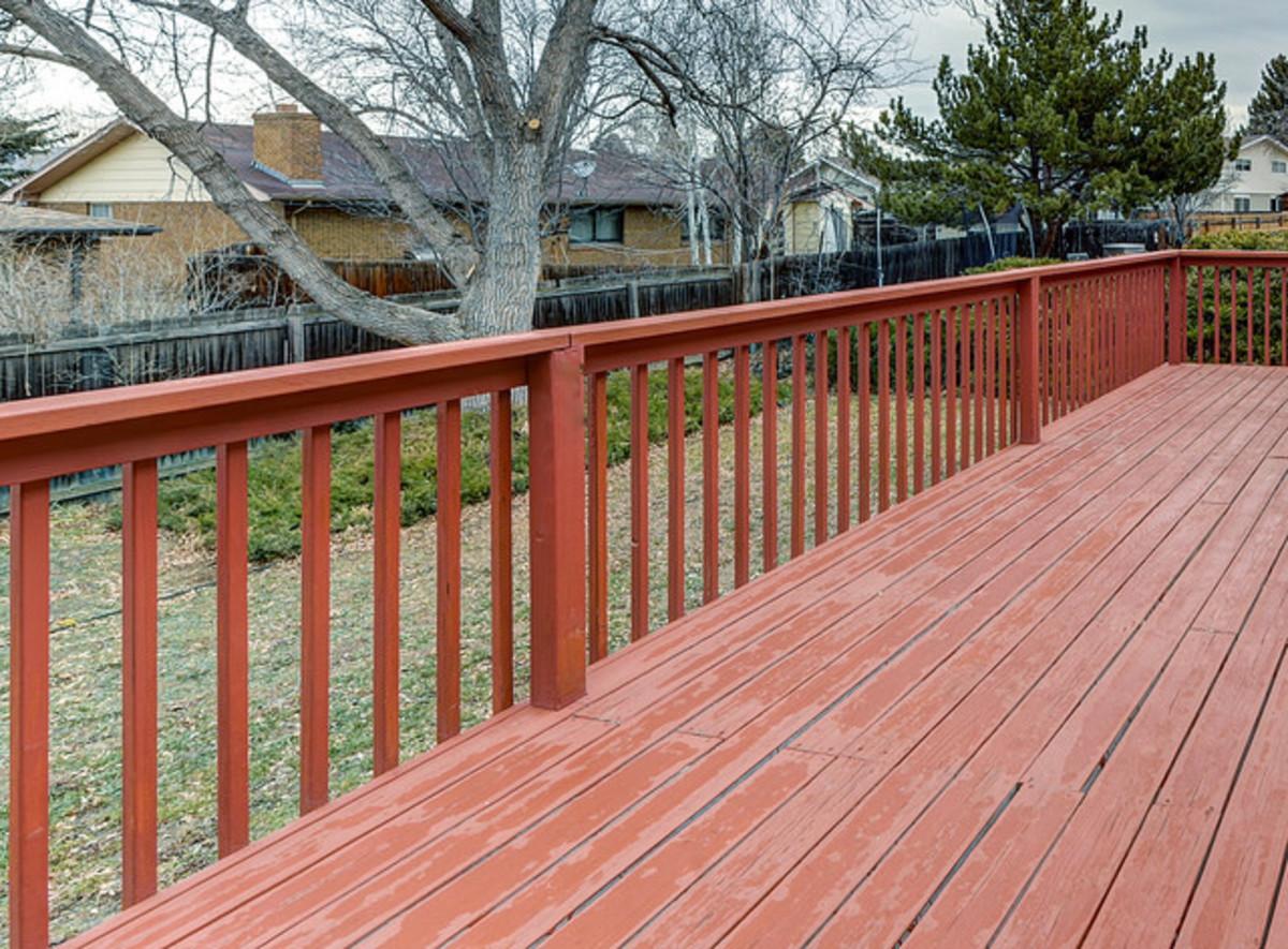Depending on the height of your deck above the ground, railings may be a required addition. Some jurisdictions may require them regardless of height.