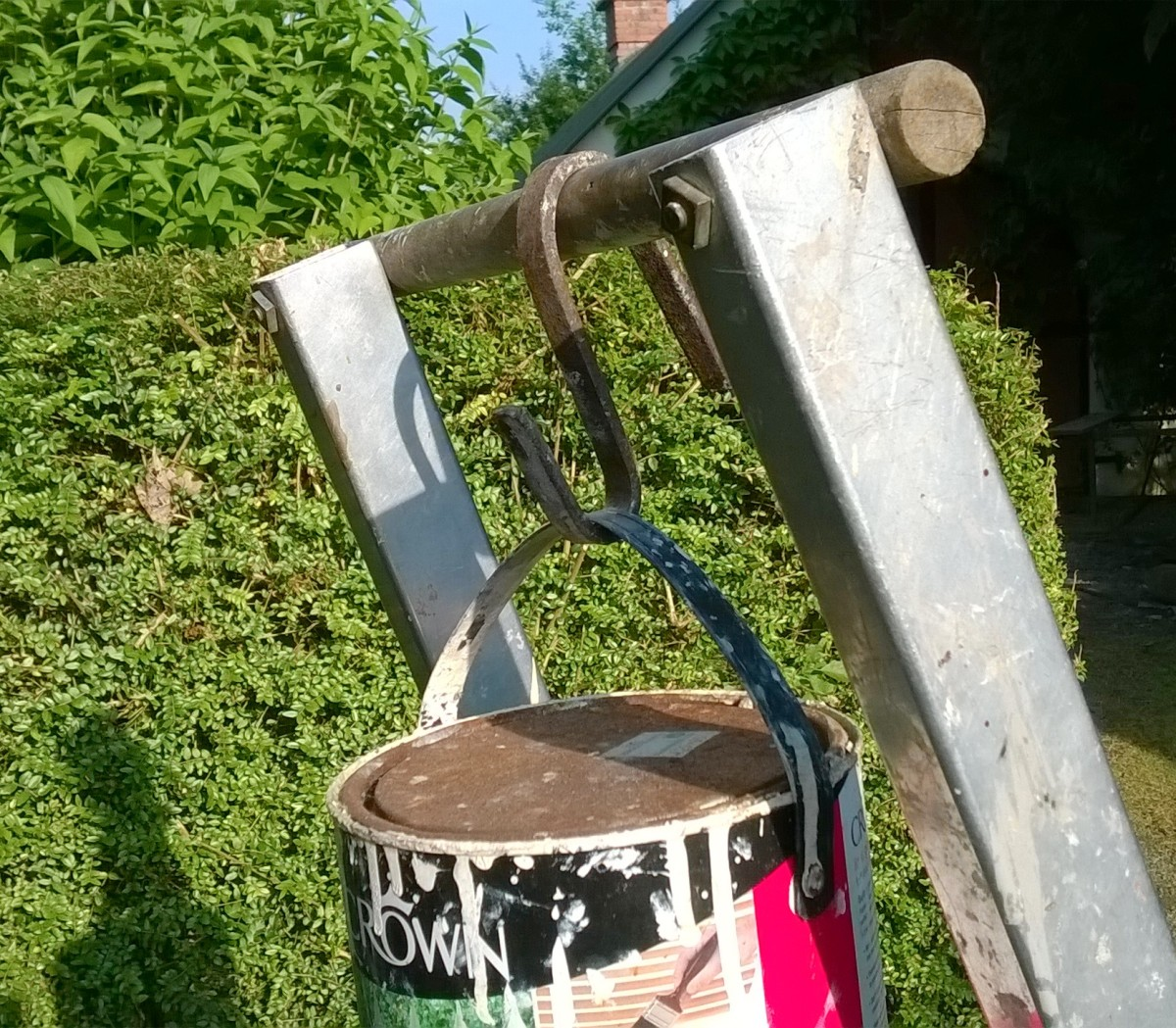 An 'S' hook is useful for holding cans of paint, buckets etc