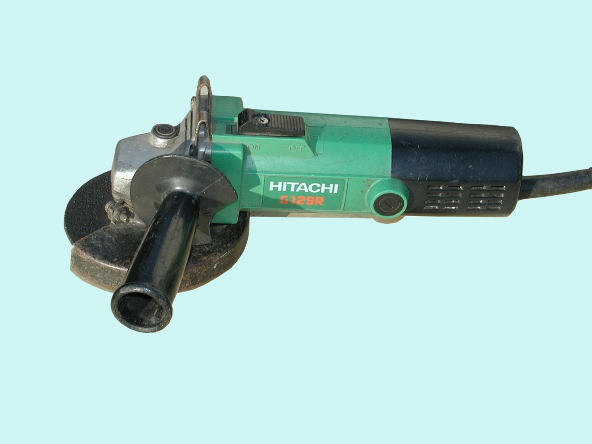 Typical 4 1/2 inch, 600 watt grinder manufactured by Hitachi, now known as Hikoki.