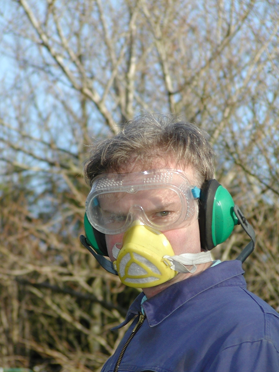Kitted out for the job with eye and  ear protection and dust mask