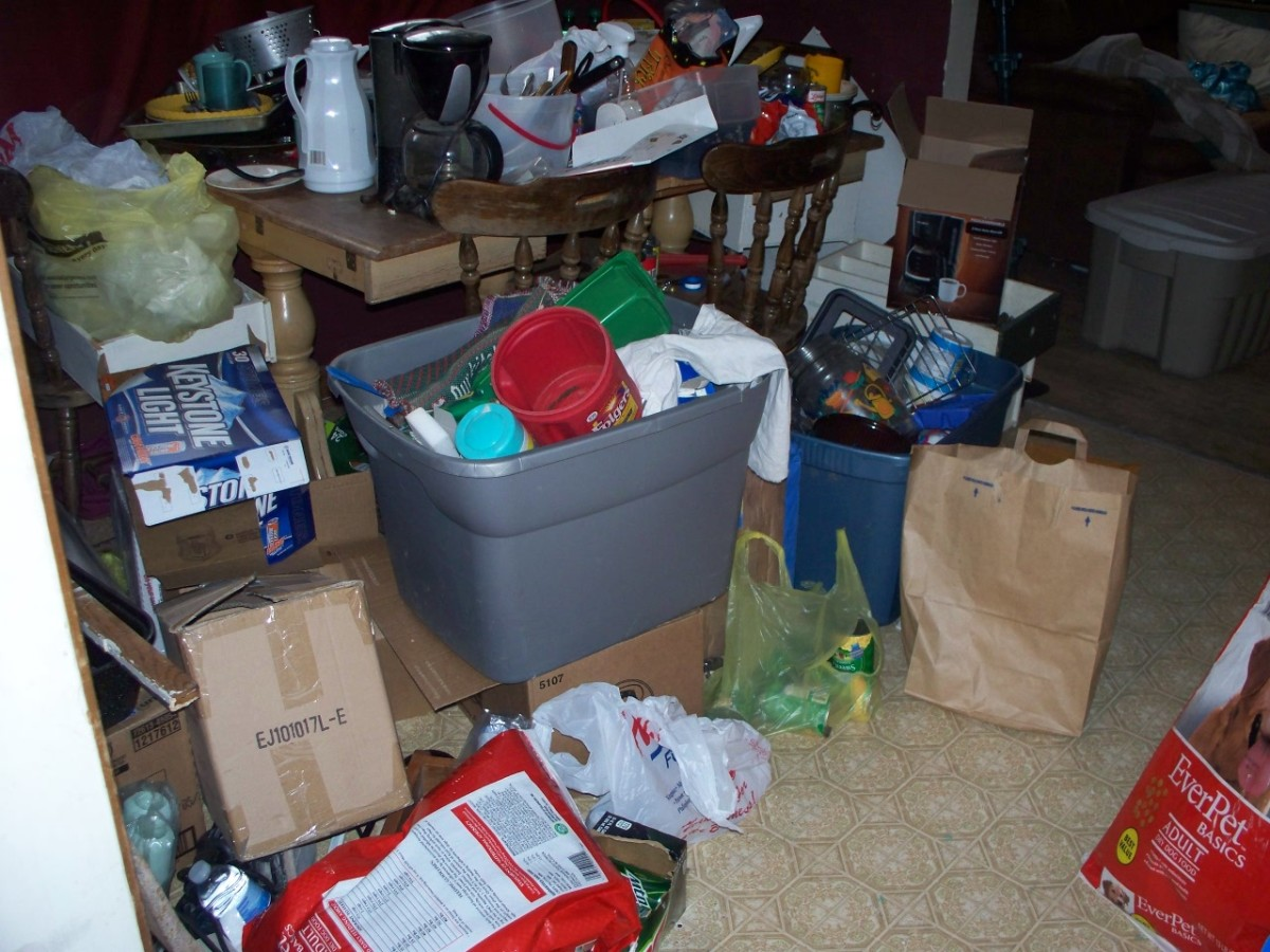 Sometimes, the kitchen table can't help but become the catch all for clutter. A few boxes and totes will help to fix that.