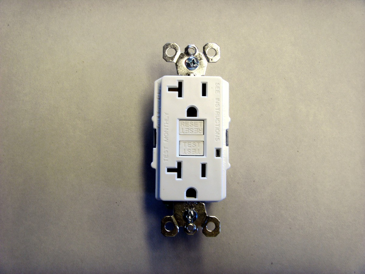 "Front view of a 20-amp GFCI outlet.  The ""test"" and ""reset"" buttons are visible in the center."
