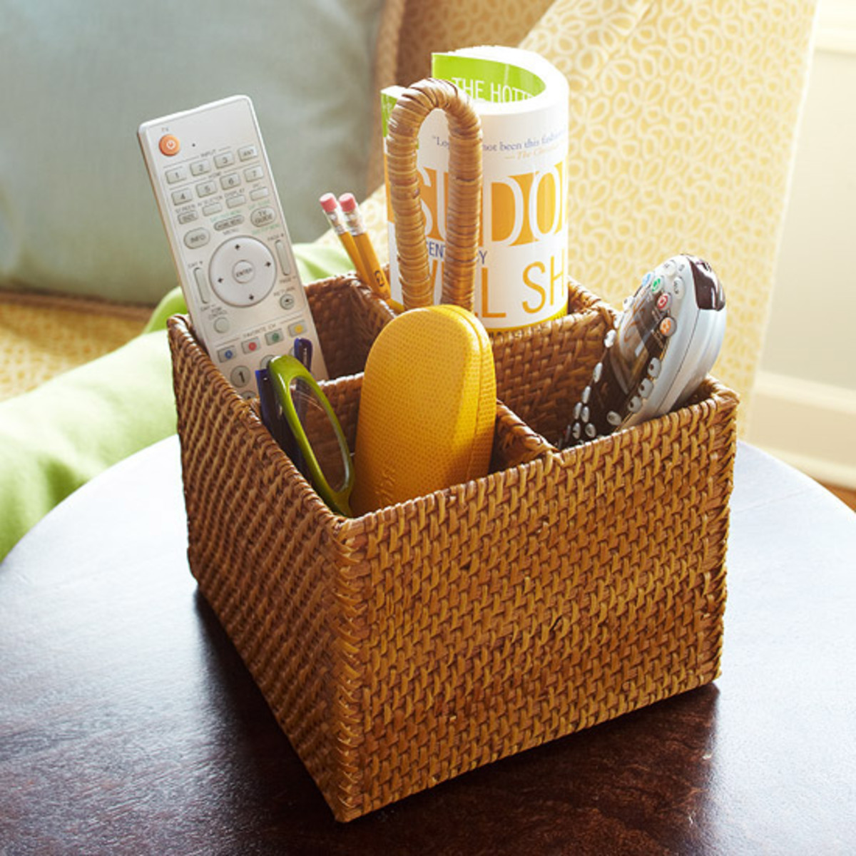 Gather up your family room essentials and store them in a divided basket.