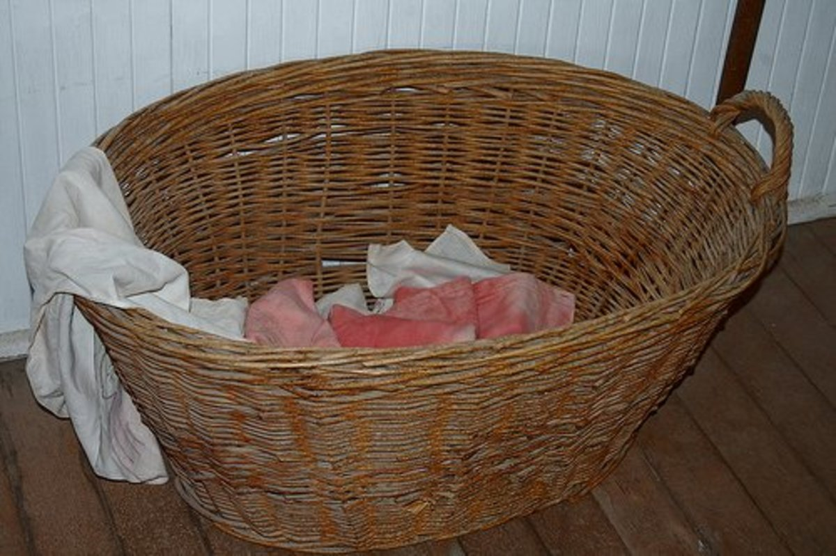 Find an old wicker laundry basket and transform it into a stylish blanket, pillow or magazine holder.