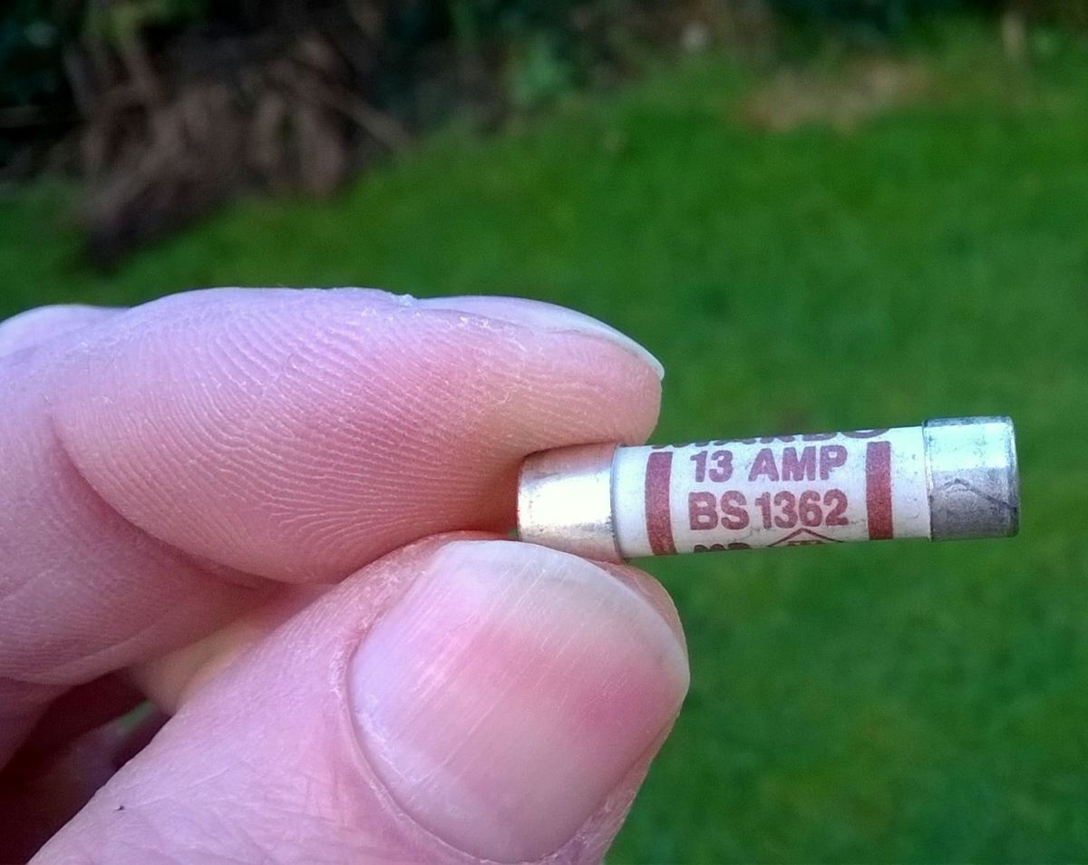 A High Breaking Capacity (HBC) BS1362 fuse, used as standard in a UK style plug.