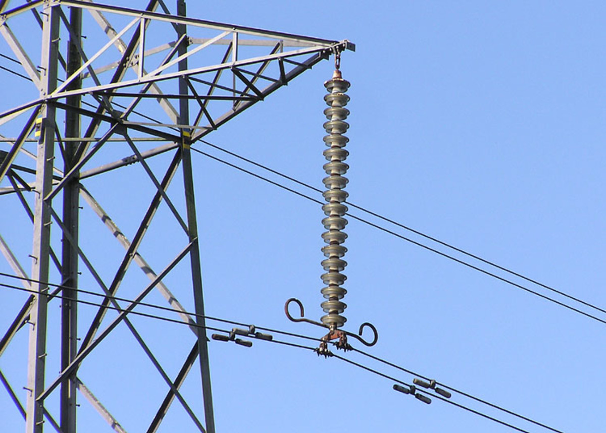 Detail of the insulator string (the vertical string of discs) on a 275,000 volt suspension tower near Thornbury, South Gloucestershire, England.