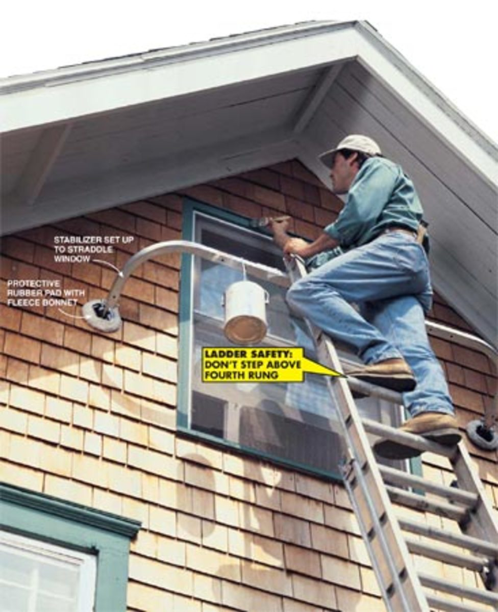Using ladder stabilizers around a window.