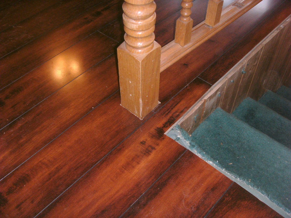 This bannister post goes through the center of a plank; if a hole is cut for it in the middle of a plank it cannot be lowered into place.