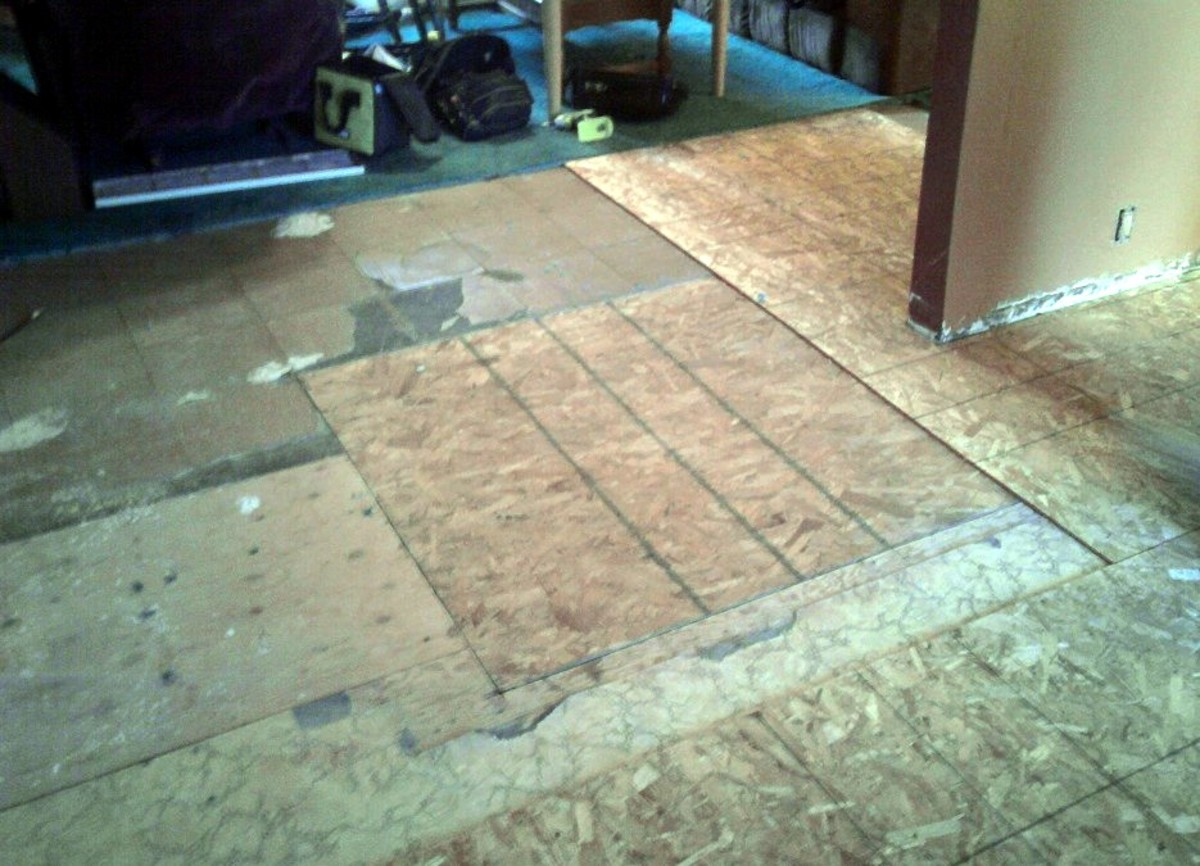 The replaced area is repaired and being covered again, along with the rest of the floor.
