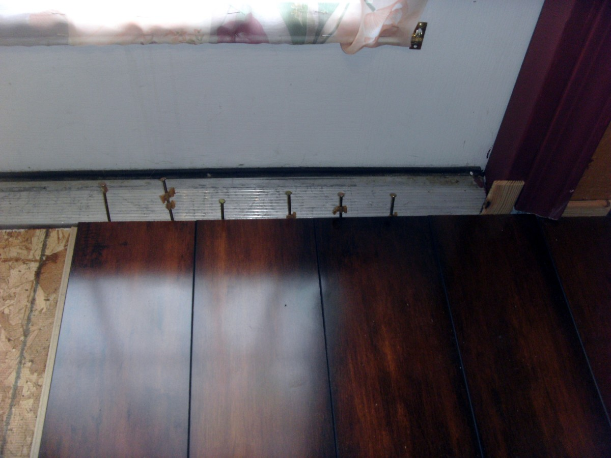 This section is in front of french doors, so nails were driven just outside the flooring into the subfloor to maintain the spacing.  Eventually a custom made transition piece will be made to go from flooring to threshold.
