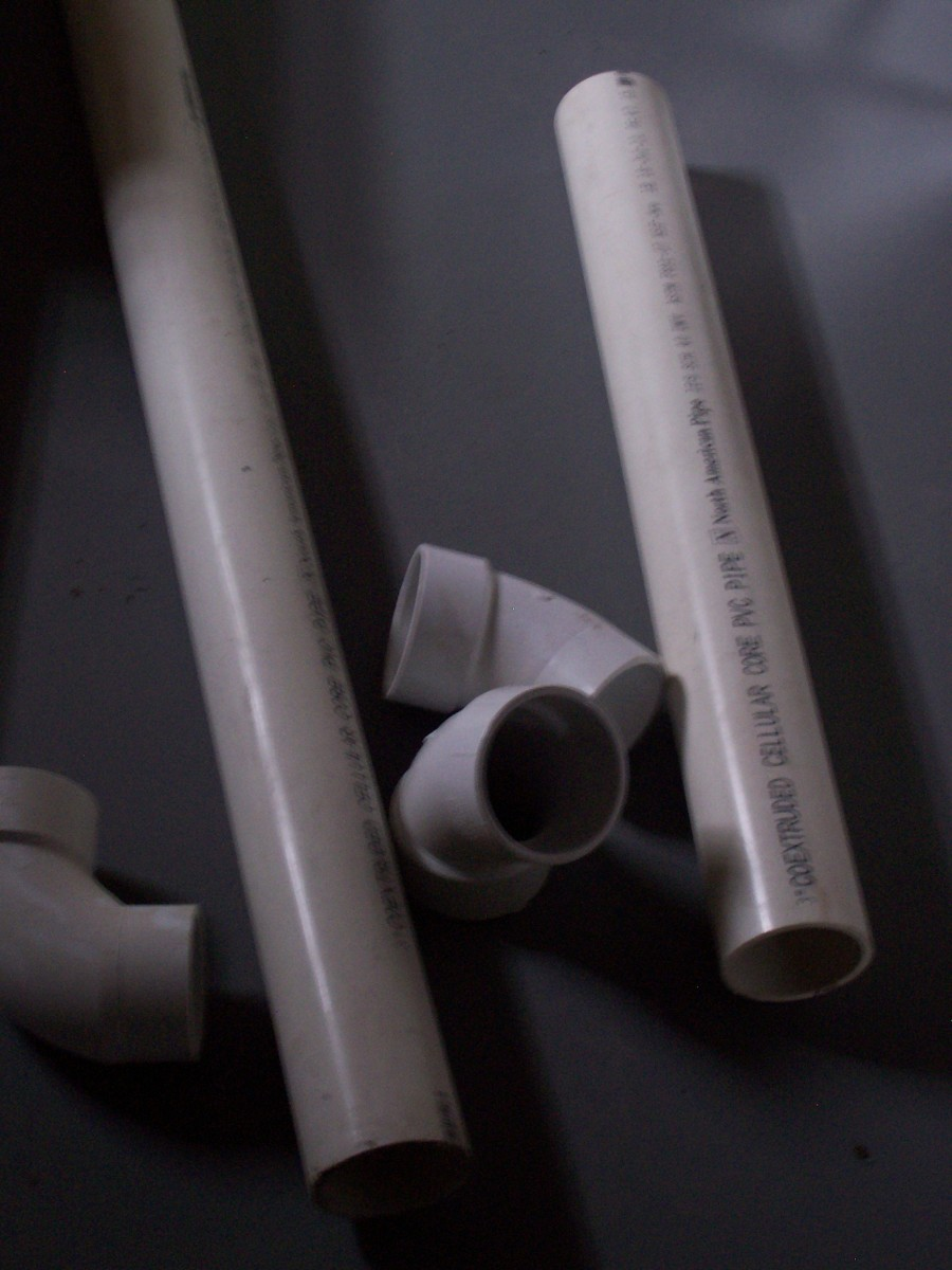 Photo #8 - PVC pipe and fittings used for the flu (chimney) on a high efficiency furnace.