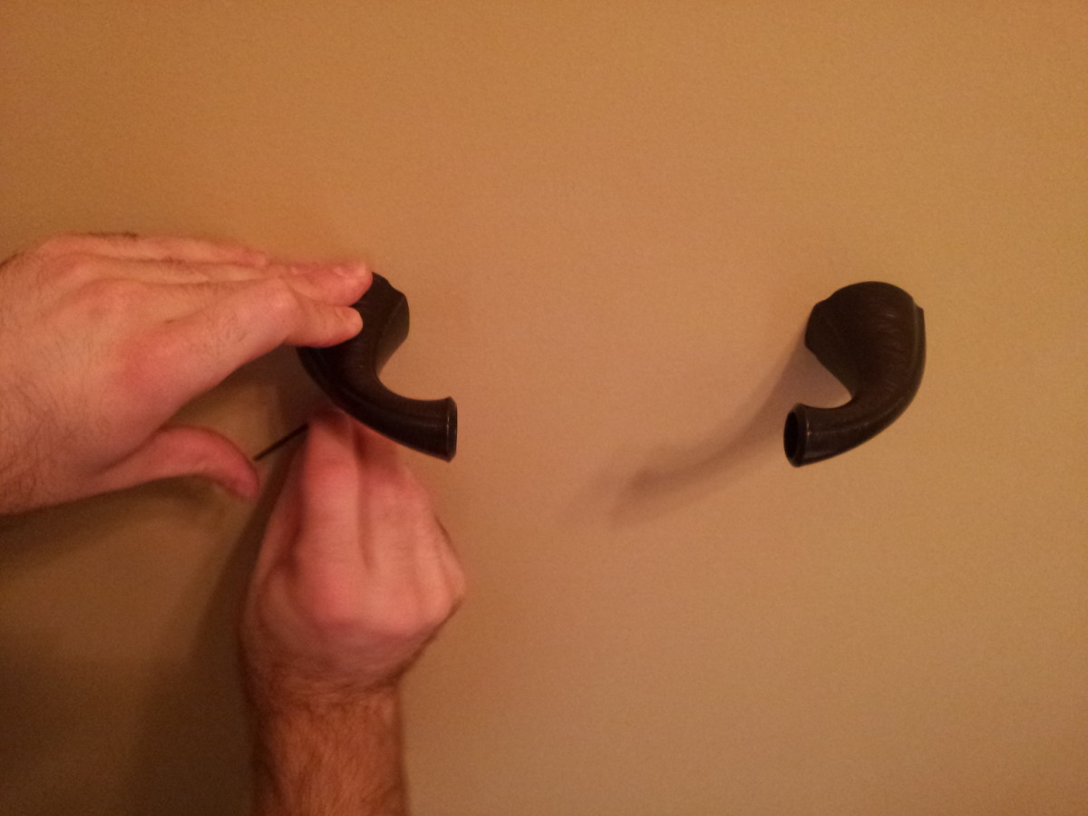 Secure the holder to the brackets by tightening the lock screws.