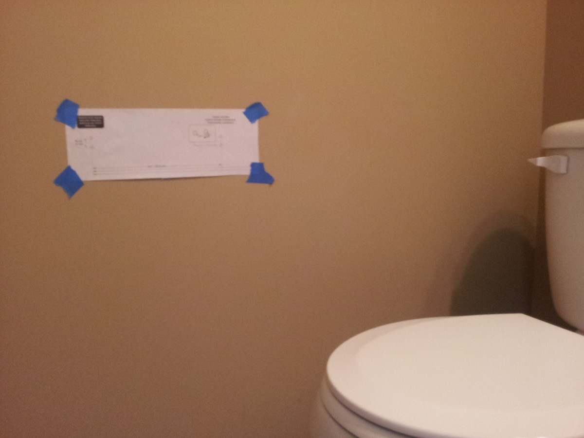 Tape the mounting template to the wall using masking tape.