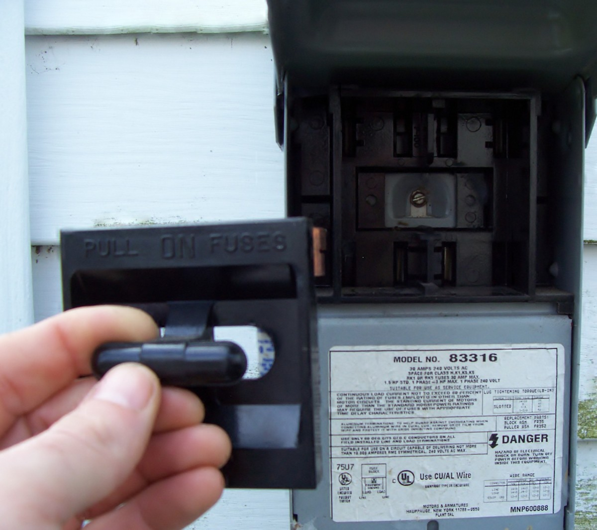 Pulling the disconnect cuts power to the condenser.