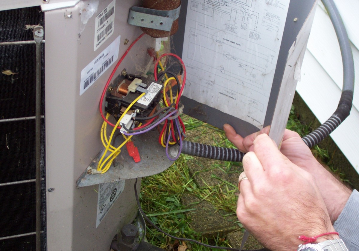 The condenser operates at 220V. Be sure to pull the disconnect before getting in here.