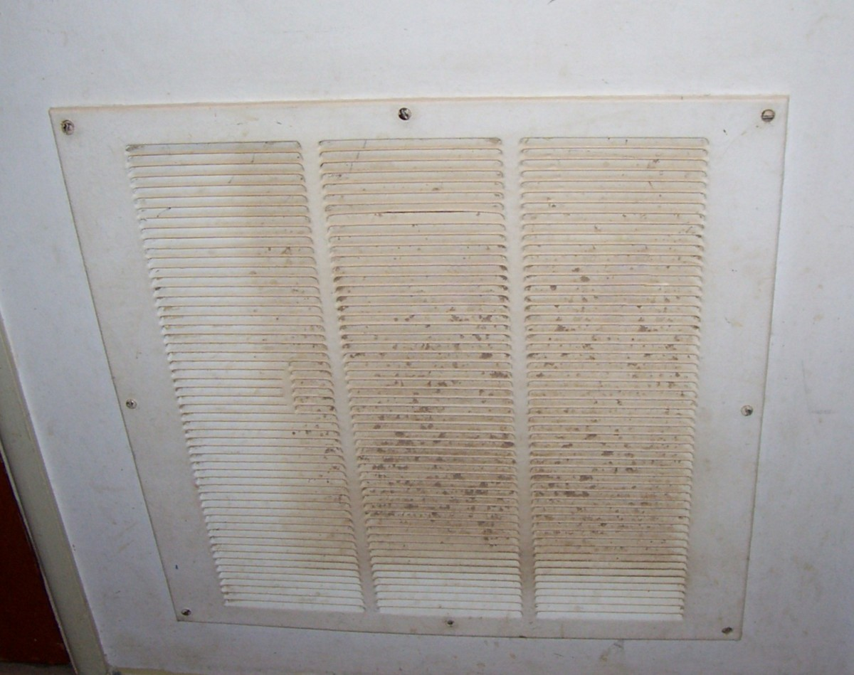 Return air registers are usually mounted to the wall.  They gather more dust and dirt than supply registers.