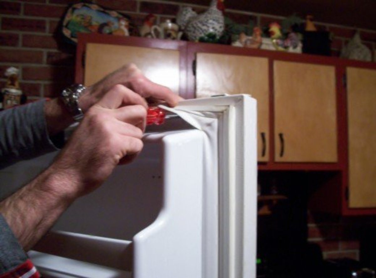 Now that the refrigerator (or freezer's) gasket it positioned correctly, finish securing it by tightening all the screws.