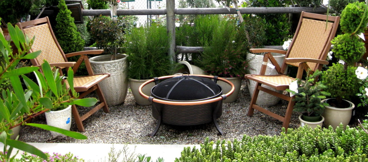 Your garden can include a small space for sitting and enjoying the warmth from a safely screened fire pit.