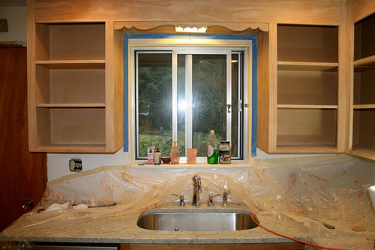 Refinishing old cabinets will save money and refresh the kitchen.