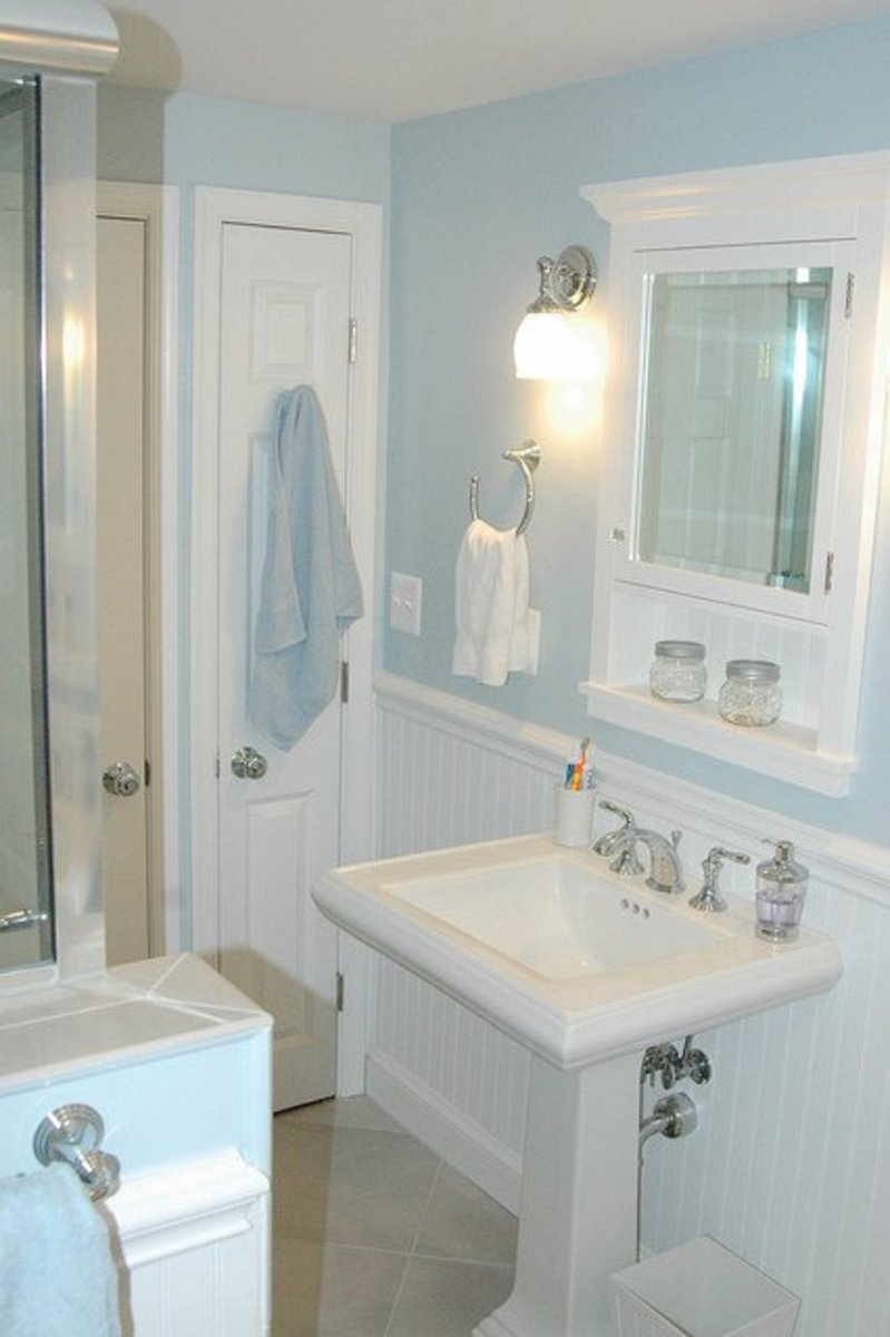 Pale blue paint looks classic, calming and clean against crisp white tile and painted wood trim.