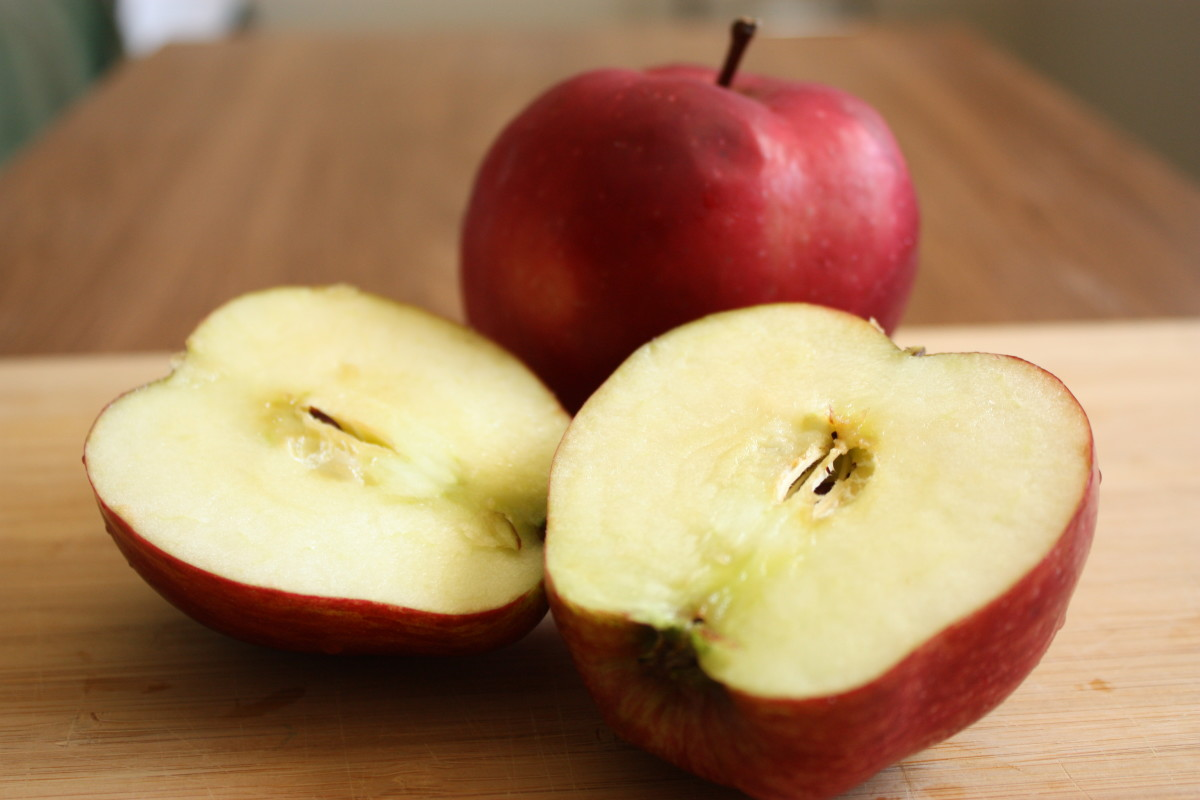 Cut apples in half to absorb unwanted odors.