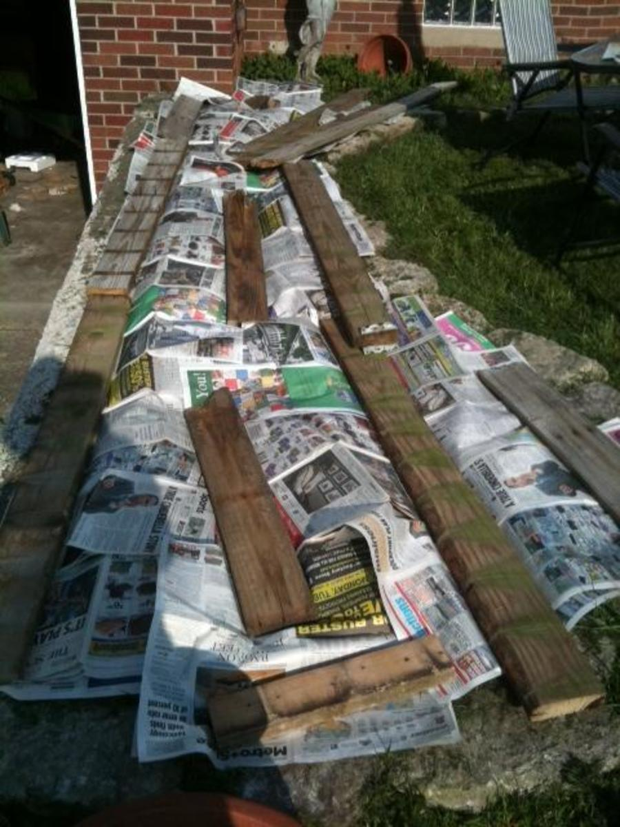 The area after the newspaper and wood have been laid down on top of it.
