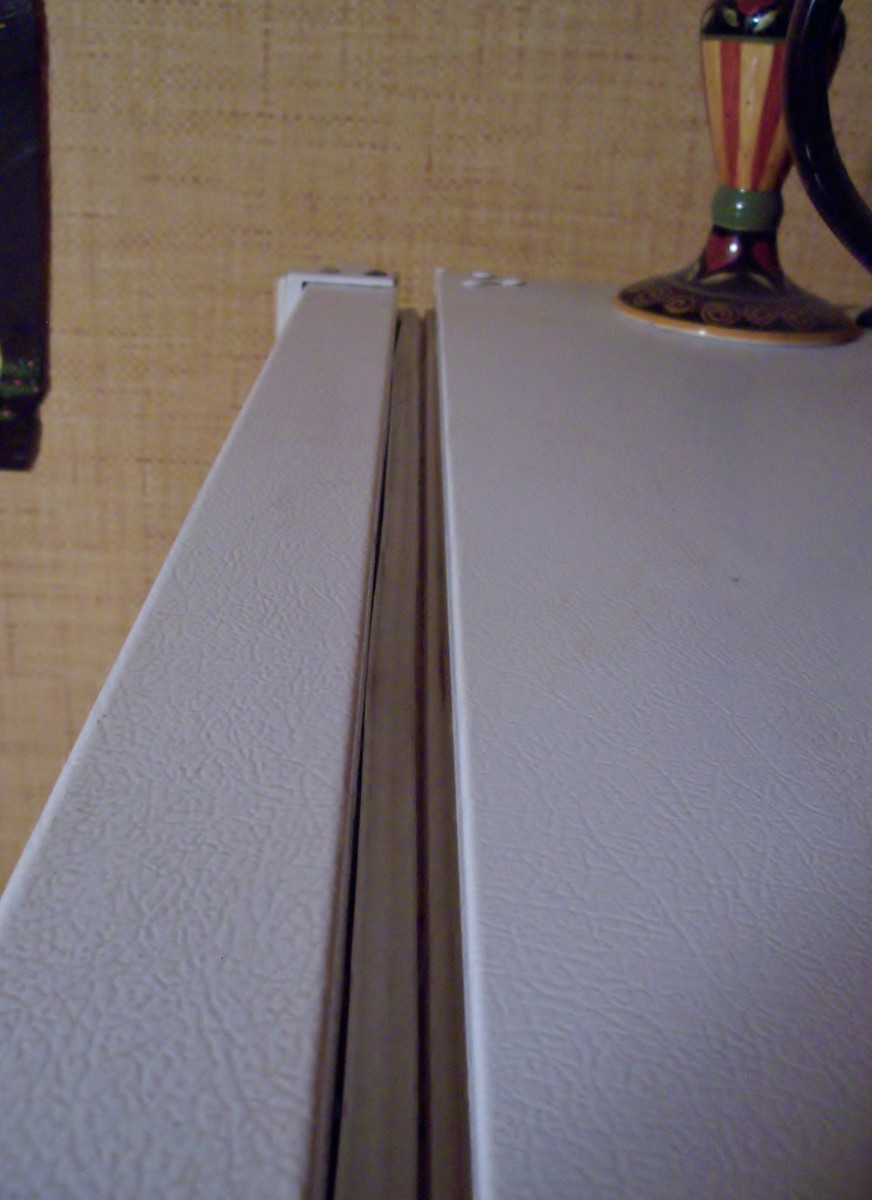 The gasket is the rubber material between the door and the cabinet.