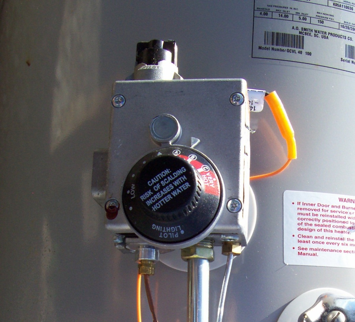 "On a more modern water heater, the controls may look a bit different like these but the concept of turning it to ""pilot"" is the same. The biggest difference here is that there is no separate pilot button. The button is the control knob."