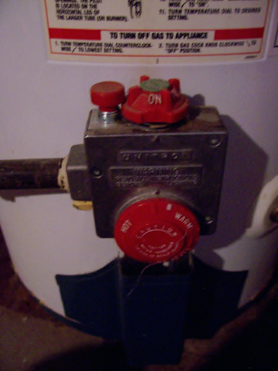 "The temperature control is the large dial in the front of this component. The burner control is on top. Notice the notch in the knob and the indicator stamped in the steel at ""12 o'clock. It is now in the ""on"" position."