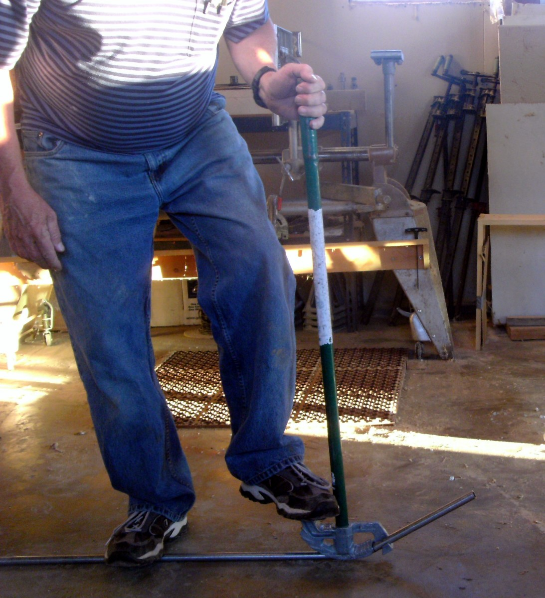 Apply foot pressure and at the same time pull the bender handle to bend electrical pipe.