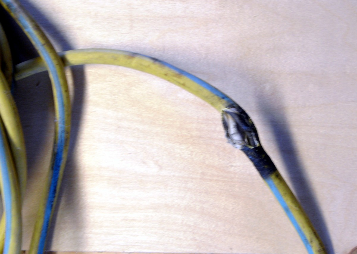 A damaged extension cord.  Either replace or repair properly - never simply throw some tape on it.